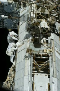 Astronauts working on an ISS module
